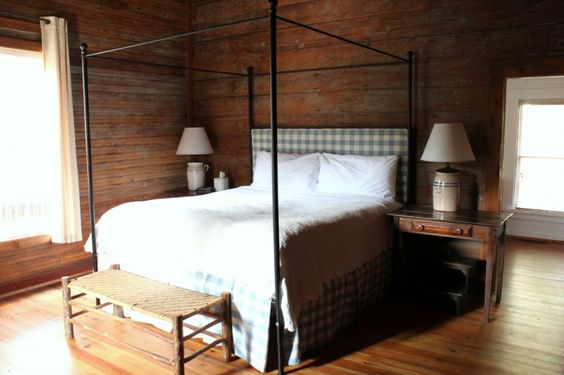 tenant cottage 7 bed with blue buffalo check headboard and bedskirt