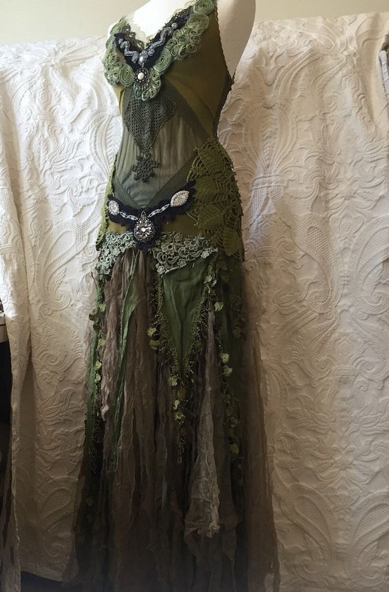 A unique beauty Woodland inspired dress . The green color are hand dyed in soft forest tones . Always thinking of a elven fairy enjoying Nature when: