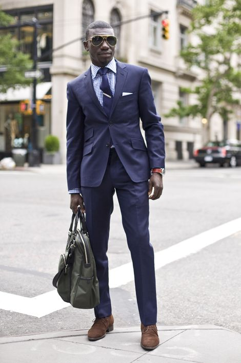 Navy suit, blue plaid shirt, navy tie, brown shoes. Accessories