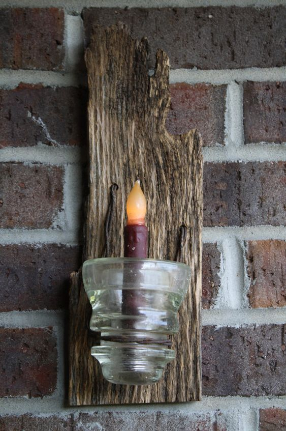 barn wood with insulator wired onto board. think I would use a tealight