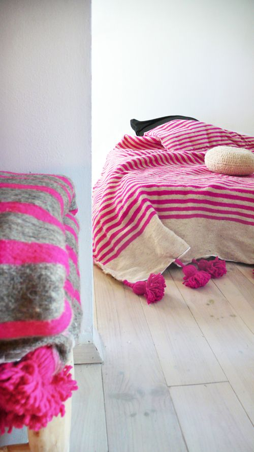 Moroccan POM POM Wool Blanket -  Pink StripesBeautiful Moroccan Blanket Wool, with pompoms on two sides. Handmade in Marrakech. Is the perfect for bed cover or sofa.Poms poms are on the top and bottom of the blanket..: Color: Ecru and Pink Stripes.: Material: Wool.: Size: 2 m wide x 3 m long. // 78,7 in wide x 119 in long.  ( /-).: Handmade in MoroccoWash at 30 degrees./. Please allow 3 days before it is ready to ship.