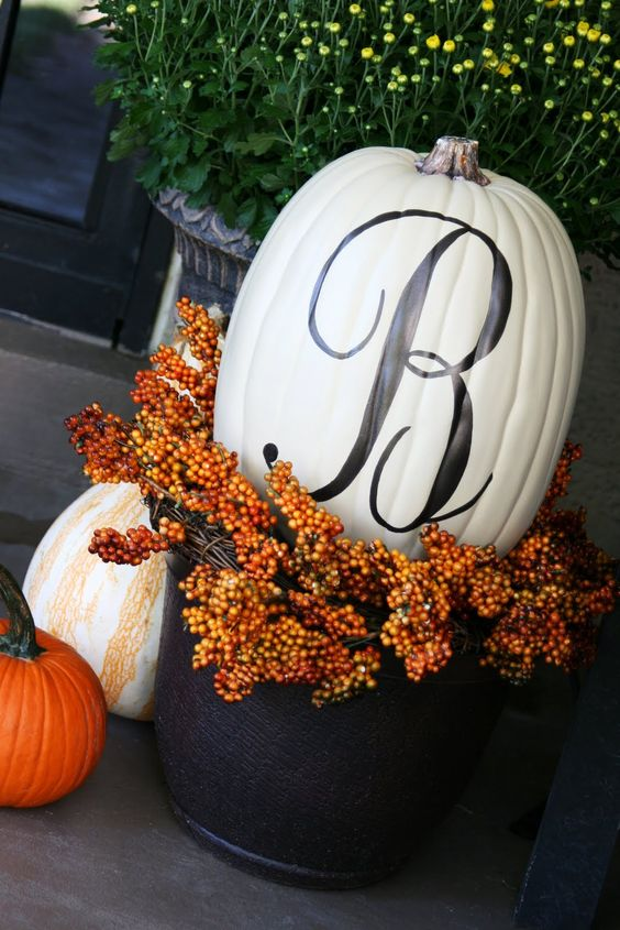 A pot a wreath and Monogramed Pumpkin cute