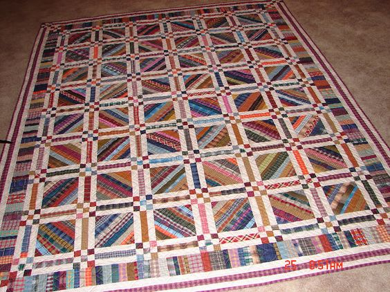 Nine Patch blocks as corner stones in this great plaid quilt!