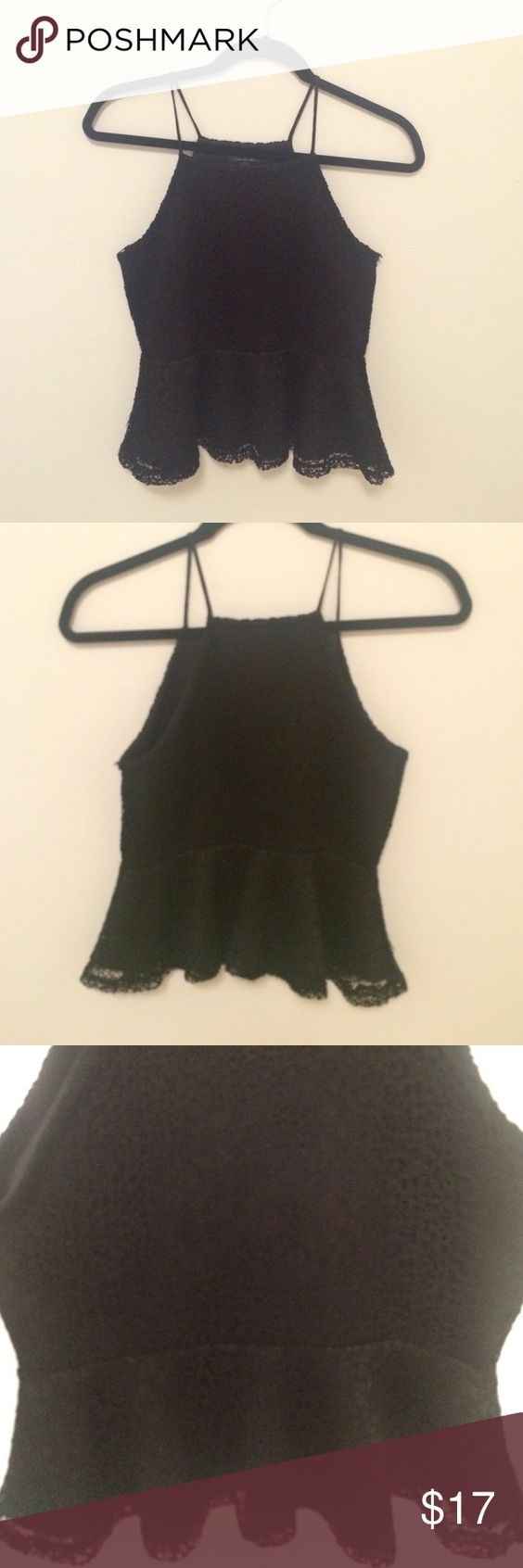 Black, lace-like peplum tank Very cute black peplum tank. The straps cut in at the shoulders so it's a flattering fit. Material is lace-like. A few threads are loose, but it's barely noticeable since the top is black. Topshop Tops Tank Tops