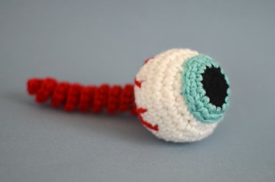 These crochet cat toy eyeballs are cute and creepy and will delight your kitty! It contains everything a cat looks for in a toy: it rolls like a