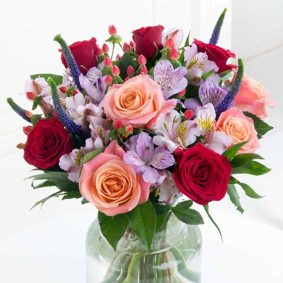 Opulent Charm - Indulge your loved one with this strikingly opulent bouquet. Beautiful Miss Piggy and Upper Class roses are the star of the show, making a truly enchanting gift.: