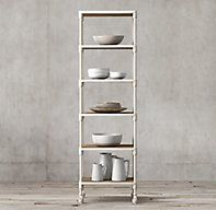 """RH's Dutch Industrial Narrow Single Shelving:Designer Luay Al Rawi's pairing of antiqued wood and distressed cast metal achieves """"form meets function"""" industrial appeal. A welded, riveted solid steel frame stands on caster wheels, while nicks, nails and imperfections speak of the wood's age and provenance."""