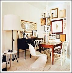 eclectic mix of chairs w/a simple color palette