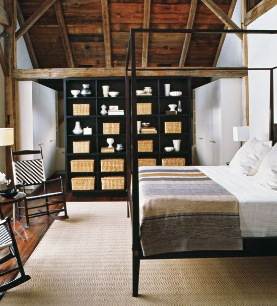 By far one of our favourite interiors, this master bedroom is housed in a renovated barn that was moved from Canada to Connecticut. With high-beamed ceilings and a simple four-poster bed overlooking a wall of windows, this is the perfect place to snuggle on a cold winter's day.