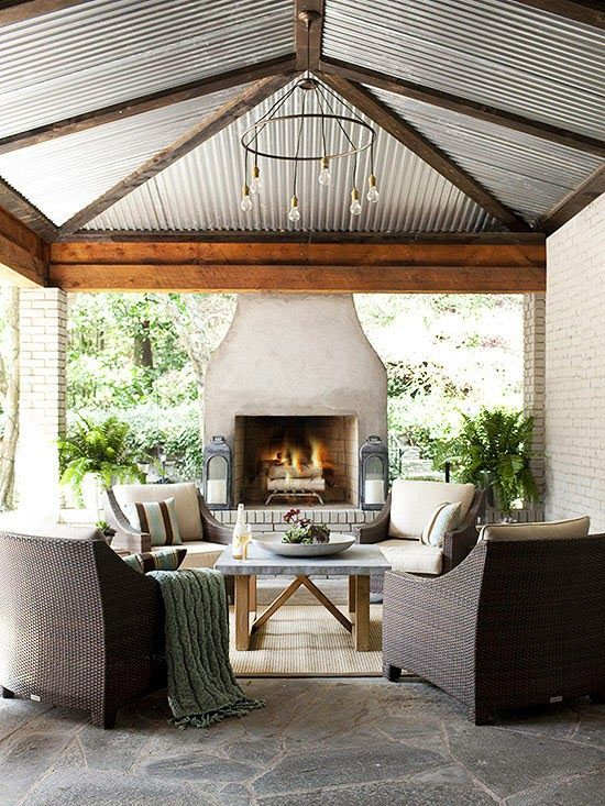 Outdoor Fireplaces Designs would love to cover the back porch with a exposed galvanized steel roof like this!