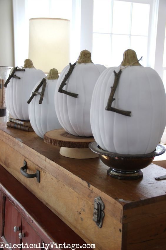Fall decorating ideas in this Eclectically Fall home tour - love the branch letters on the pumpkins! Kellyelko.com