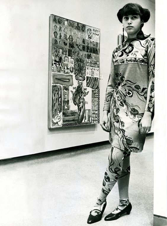"""Hairy Who artist Suellen Rocca with her painting """"Curly Head"""" (1967), unidentified materials and unspecified dimensions (photo by Bob Kotalik, Chicago Sun-Times, courtesy Pentimenti Productions)"""