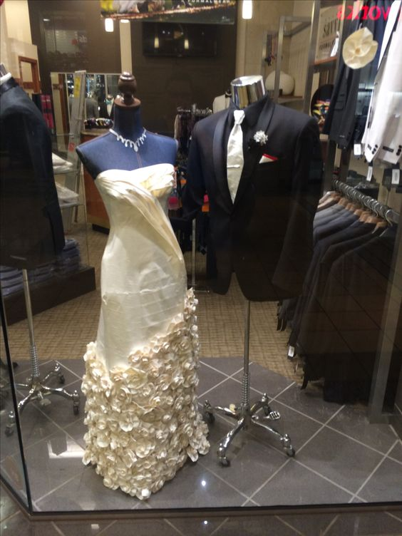 Window decor for a men's formalwear shop. Dress made out of duct tape.