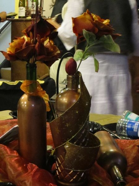 Bronzed bottles centerpiece.. easy DIY! Add a few gears, an octopus or airship too!