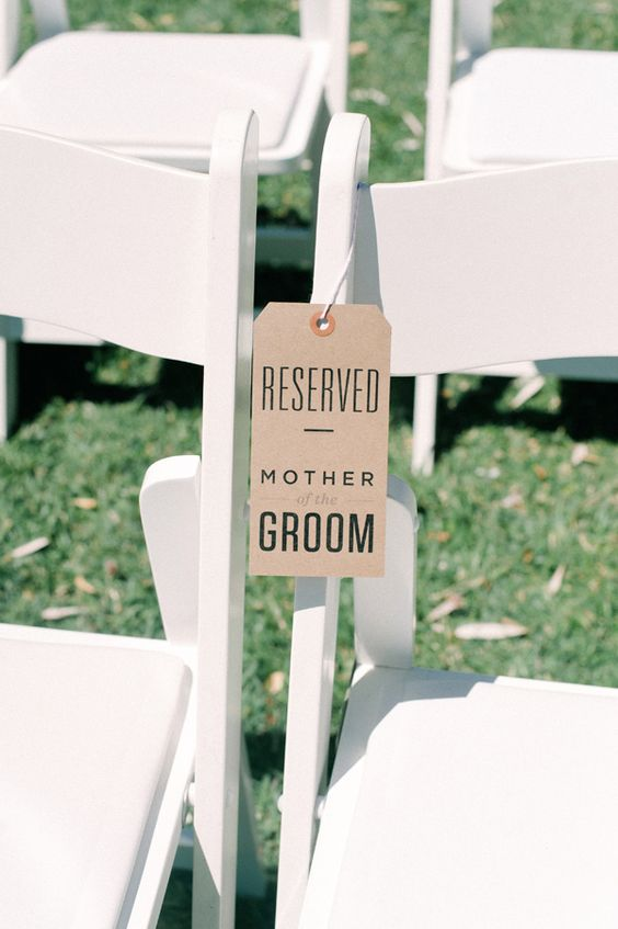 "So cute! Make your moms feel special by adding a ""Reserved"" sign to their chairs during your ceremony. Such a cute DIY detail, too!"