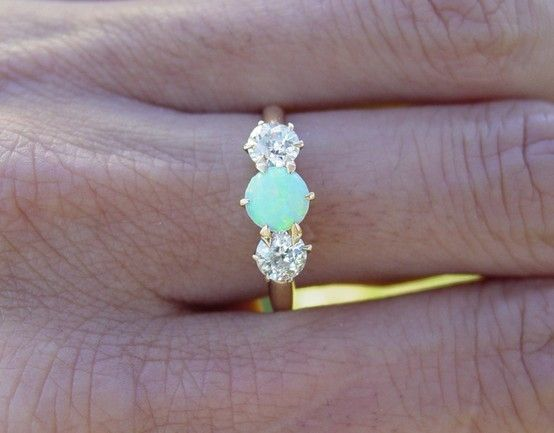 Vintage opal and diamond engagement ring. Put it on a silver band & I might have found the love of my life.