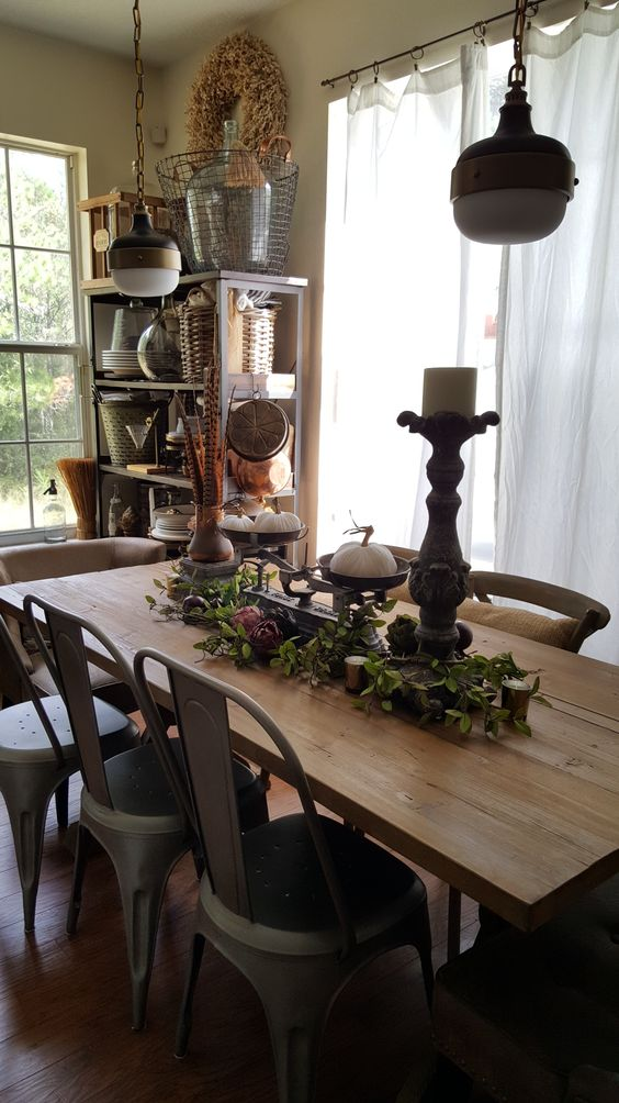 dining wood table white pumpkins pheasant feathers artichoke garland