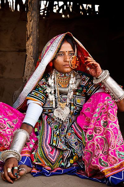 India   Portrait of a woman from the Marwada Meghwal Harijan tribe wearing traditional clothing and a large golden wedding ring through her nose in the village of Hodka, located roughly 60km from Bhuj in the Kutch District    © Kimberley Coole