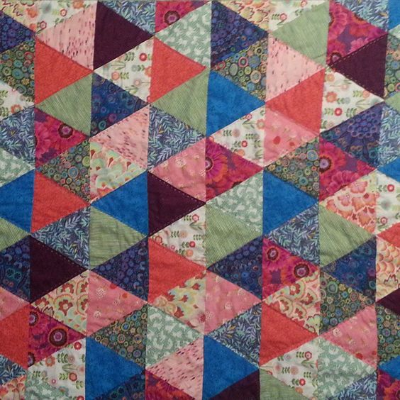 Quilt by Janet Flagel and Nadine Flagel. A baby quilt my mother and I made: she pieced the top and layered it all and I handquilted it in a diamond pattern.