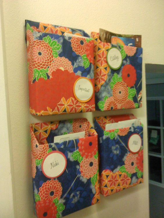 cereal boxes turned mail sorters covered in wrapping paper and attached to the wall with velcro!