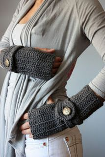 Gray fingerless gloves with wide wrist band.