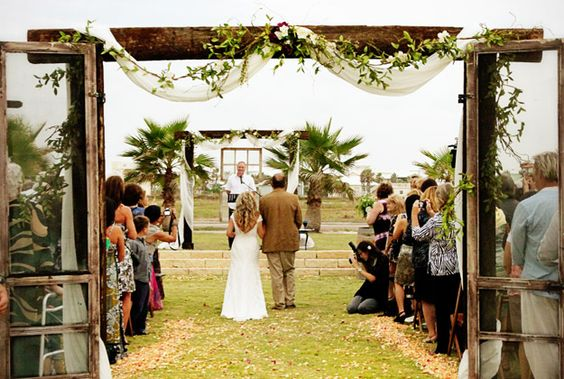 Walking down the aisle. http://www.cinnamonshore.com/weddings/