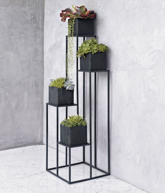 Quadrant Plant Stand with Four Planters in Garden, Patio | Crate and Barrel: