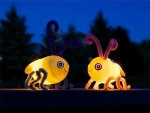 Lightning bugs made out of plastic easter eggs!  just put a flameless tealight inside the eggs and they will glow at night by iris-flower
