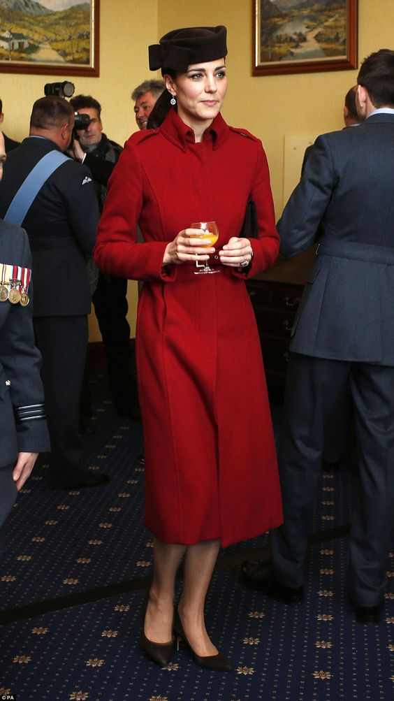 Looking her usual stylish self, 34-year-old Kate, pictured drinking orange juice, paired the elegant outerwear, called 'Ami' from the high-street label's Autumn/Winter 2011 collection, with a dark brown bow-adorned hat by one of her favourite milliners, Lock&Co: