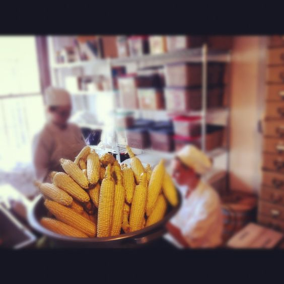 Local corn, courtesy Greensgrow Farms, being prepped in the kitchen for an ice cream base