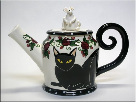 a bit of whimsy.....love cat tea pots