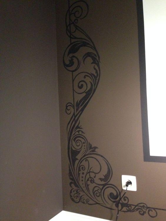 Omkadering muur zwarte krullen muurschildering