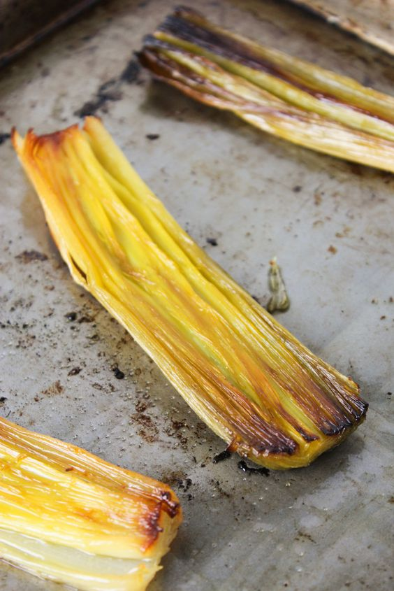Simple Slow Roasted Leeks -- these are the best and so easy! Buttery, aromatic, and flavorful with just a bit of olive oil and sea salt. A++++++