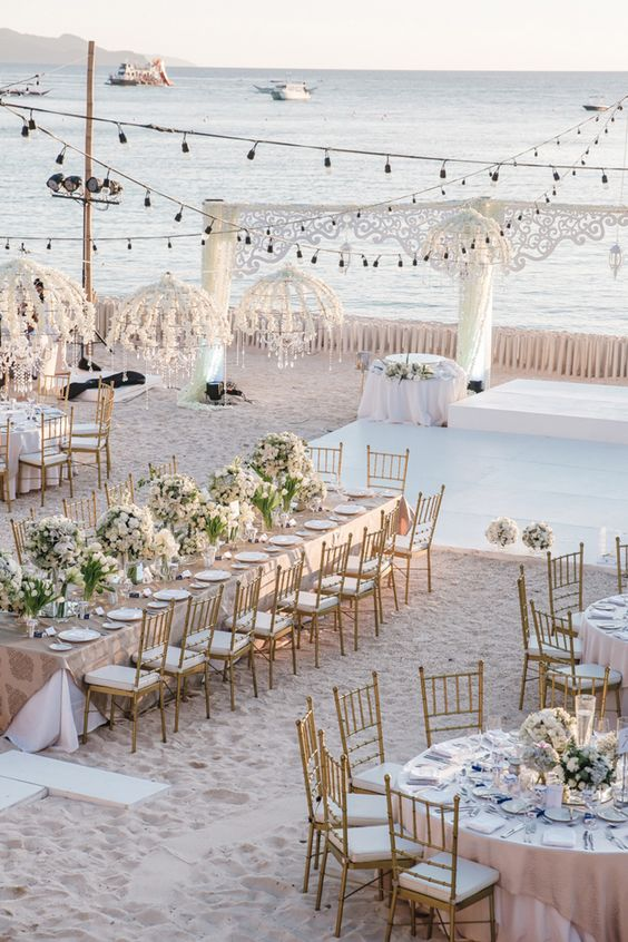 Incredibly beautifully styled beach side wedding venue in Boracay Philippines // Matt and Katy wed in a beautiful beach ceremony at Shangri-Laâ??s Boracay Resort & Spa, Philippines. Their nuptials were planned by Boracay Weddings by Amanda Tirol, styled by Teddy Manuel, and captured by Mayad Boracay. We especially love the brideâ??s effortless wedding day look, which was completed with a lovely off-shoulder Rosa Clara lace gown.