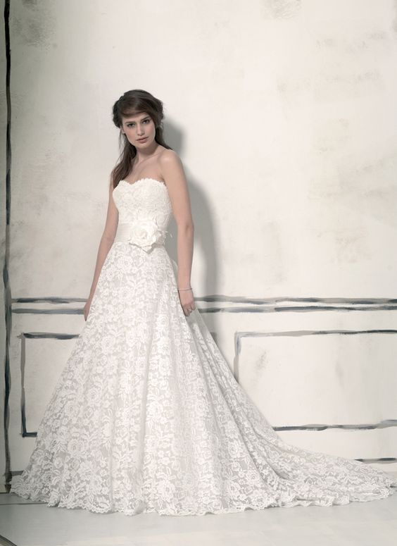 Justin Alexander jar style 8557 Corded lace circular cut ball gown with gathered Silk Dupion waistband highlighted with a detachable 3D flower. This dress has a sweetheart neckline and has a �semi cathedral length train.