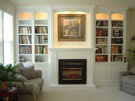 Tv Above Electric Fireplace With Bookshelves Built In Custom Cabinets And Bookcases For