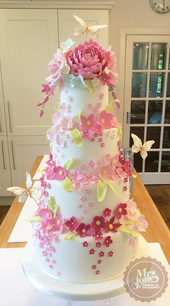 Based on an idea by Rosalind Miller Cakes in London, there are lots of flowers and leaves on this cake. Alan Dunn taught me to make those really cute butterflies.