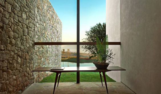I want everything about this in my house. The stone, the glass, the table, the plant, the view.