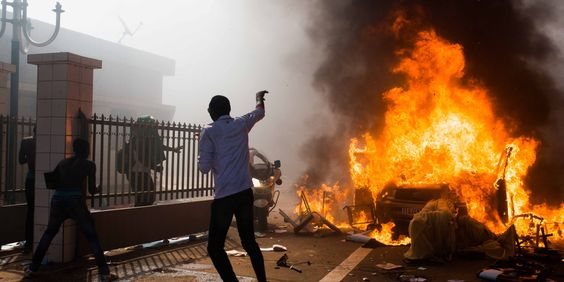 OUAGADOUGOU, Burkina Faso (AP) — The president of Burkina Faso stepped down Friday after protesters stormed parliament and set the building ablaze, ending his 27-year reign and sparking a struggle in the military for control of the West African...