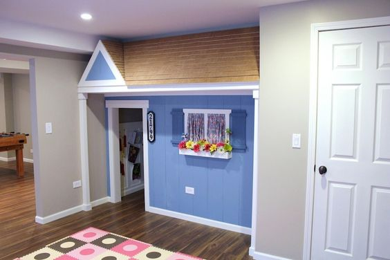 How cute is this!  created out of a closet in their playroom, the roof is hinged for extra storage! Pure genius!