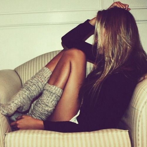 Wool socks and big sweater. For similar knitwear visit…