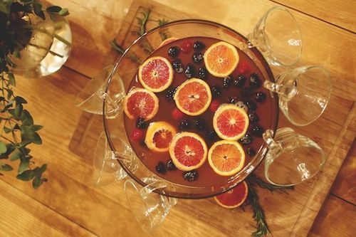 Holiday Berry Bourbon Punch Recipe. The answer to the best match to your holiday entertaining. The right mix of festive cheer in a glass. #holiday #party #drinks