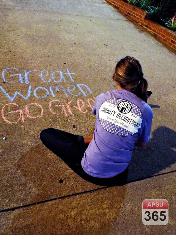 APSU 365: Day 8 ––A sorority member creates a chalk message on the sidewalk inviting APSU students to participate in sorority recruitment o...