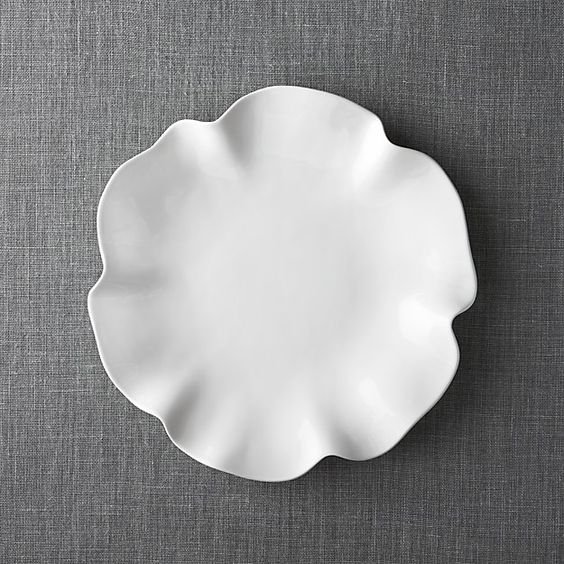 Freeform waves of ruffles and folds in high-gloss white earthenware make a big impression at the table or buffet. Platter and dip/condiment bowl work separately or as a team (see additional photos).