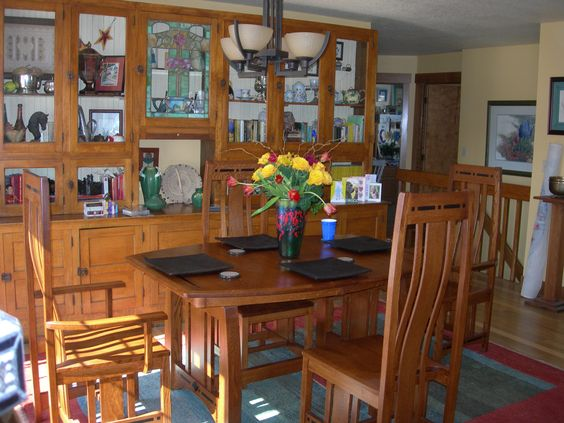 Simply Amish dining room furniture in front of an old back bar.