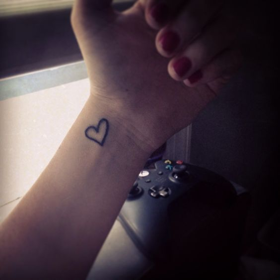 Tattoo complete. A simple heart on my wrist for suicide awareness in memory of my dad.