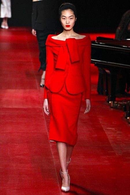 Nina Ricci, Fall 2013, petal cut at the bottom of blouse, extra sleeves for sweatshirt tied around shoulder look.