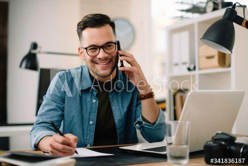 Businessman in office. Handsome man talking on phone at work in 2020 |  Business man, Handsome men, Man