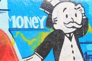 Graffiti wall picture of the Monopoly man photo