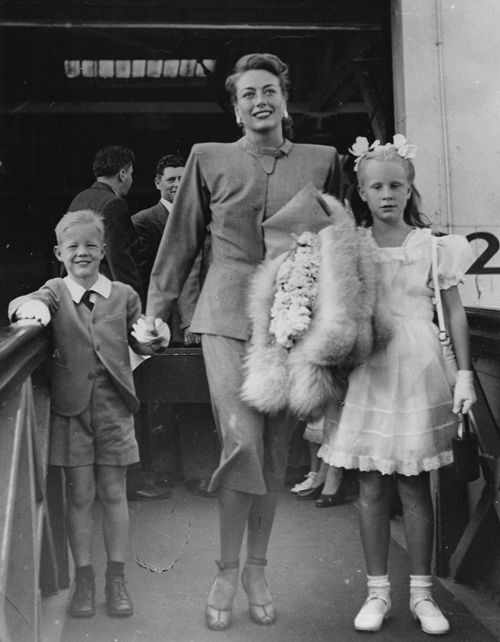 Joan Crawford with two of her adopted children, Christina  Christopher.  After Joan's death Christina would write a damning account of their life together.
